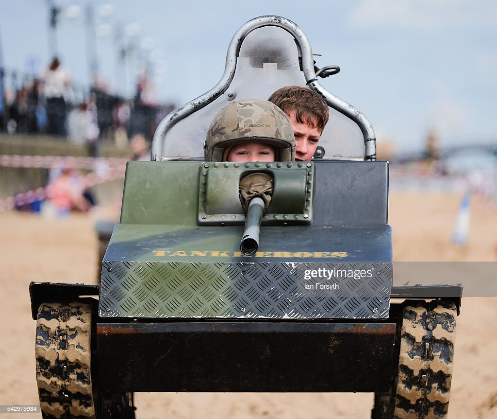 A young boy drives a model tank during the Armed Forces Day National Event on June 25, 2016 in Cleethorpes, England. Armed Forces Day is an annual event that gives an opportunity for the country to show its support for the men and women in the British Armed Forces. The visit by the Prime Minister came the day after the country voted to leave the European Union.