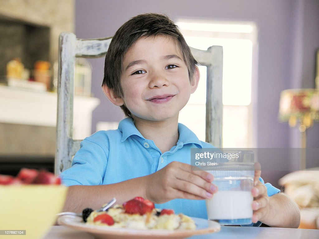 Young Boy Eating Breakfast : Stock Photo