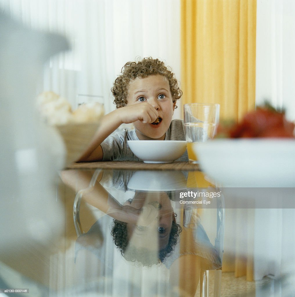 Young Boy Eating Breakfast : Stock Photo