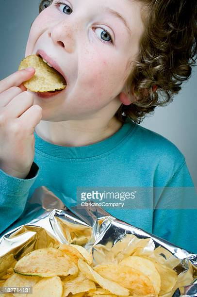 Young Boy Eating Potato Crisps