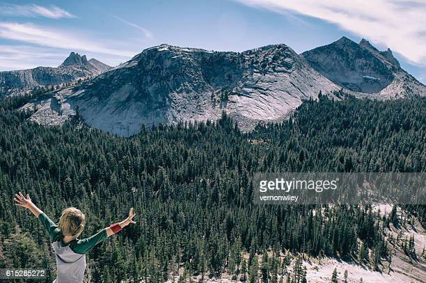 Young boy embracing the beauty of Tuolumne Meadows