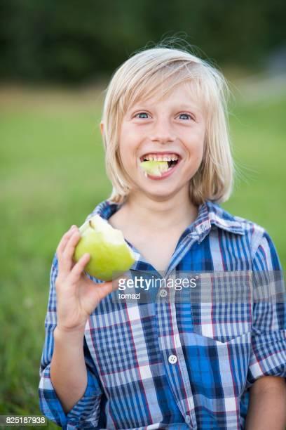 Young boy enjoying his apple
