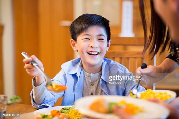 Young boy enjoying lunch