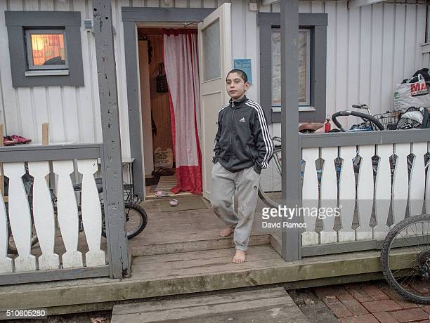 A young boy from Afghanistan looks on in front of the temporary home of the Merzai family in a summer holidays resort on February 7 2016 in Halmstad...