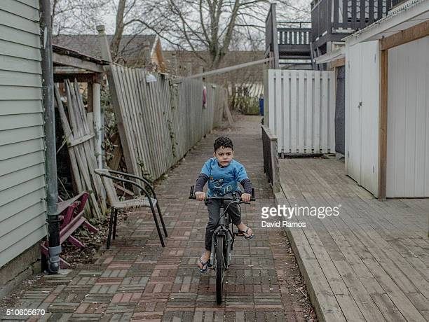 A young boy from Irak rides a bicycle in a summer holidays resort where he lives with his family for the last 4 months on February 7 2016 in Halmstad...