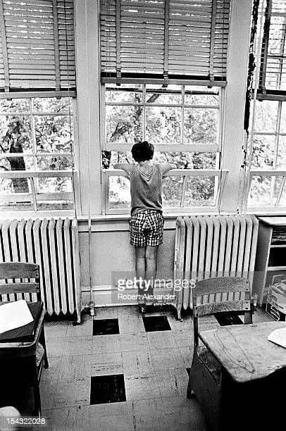 A young boy gazes out the classroom window on the last day of school at William King Elementary in the Appalachian town of Abingdon in Southwest...