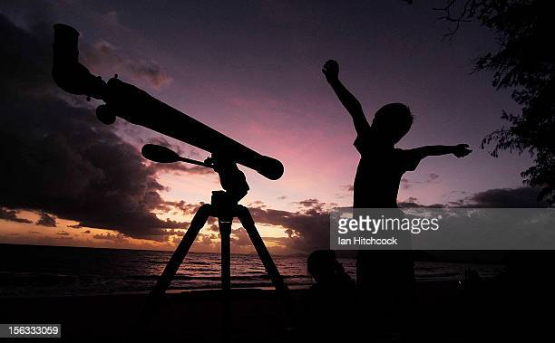 A young boy gets ready to view the solar eclipse with his telescope on November 14 2012 in Palm Cove Australia Thousands of eclipsewatchers have...
