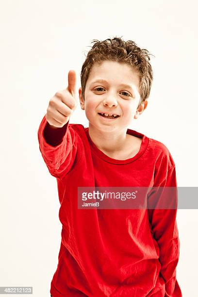 Young boy giving thumbs up gesture