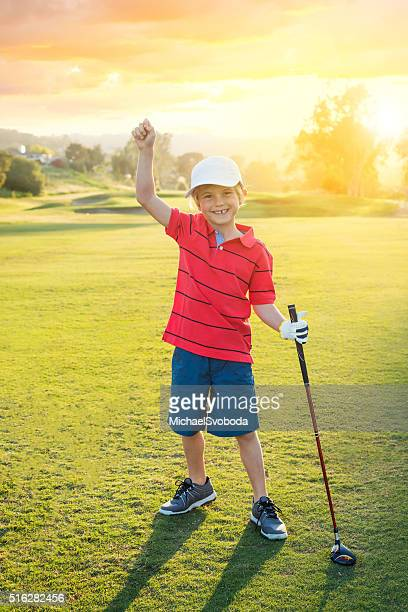 Young Boy Golfer Celebrating During Sunset