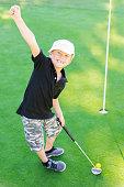 Young Boy Golfer Celebrating During Sunset