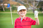 Young Boy Golfer Celebrating During SunsetYoung Boy Golfer On The Putting GreenYoung Boy Golfer On The Putting Green