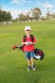 Young Boy Golfer Walking Down the Fairway