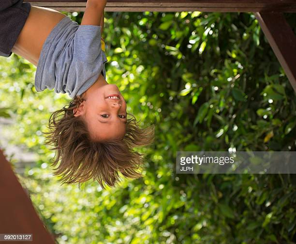 Young boy hanging upside-down
