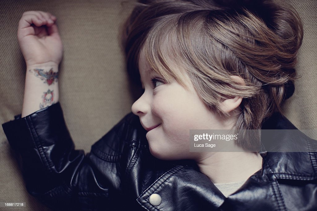 Young boy happy with his tattoos : Stock Photo