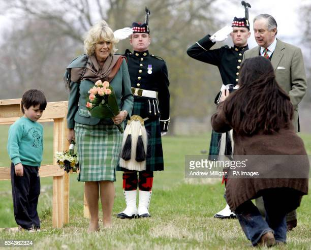 A young boy has his photograph taken with their Royal Highnesses The Prince of Wales and the Duchess of Cornwall after they unveiled the new Queen...