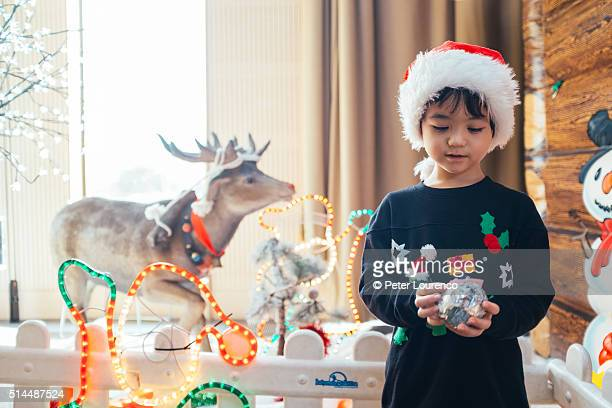 Young boy holding a Christmas gift