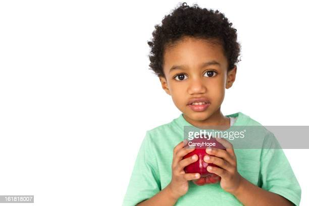 young boy holding apple
