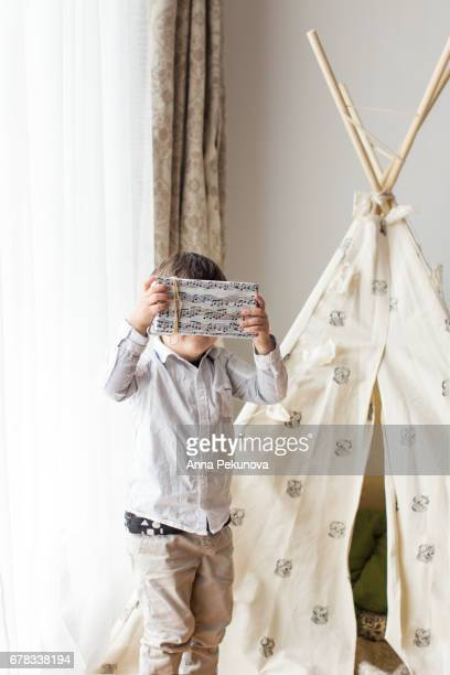 Young boy holding birthday present