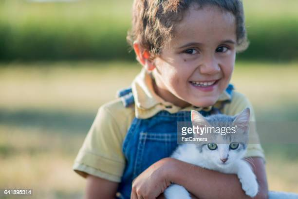 Young Boy Holding His Kitten