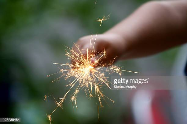 Young boy holding sparkler