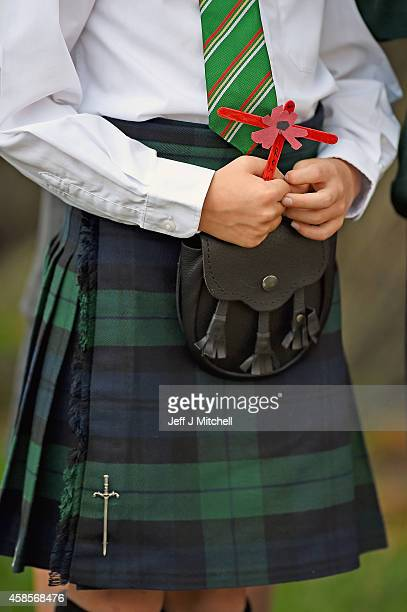 A young boy holds a cross and wears a kilt as families veterans and soldiers from The Black Watch 3rd Battalion the royal Regiment of Scotland attend...