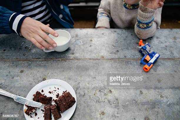 Young boy in a cafe with his mother
