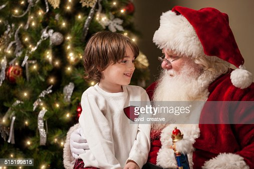 Young Boy in Awe Sits on Santa's Lap