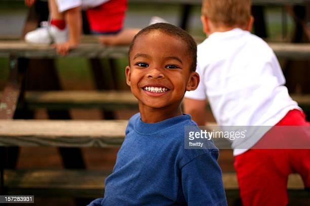 Young Boy in Bleachers 1