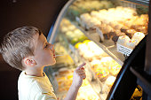 Young boy in cake shop