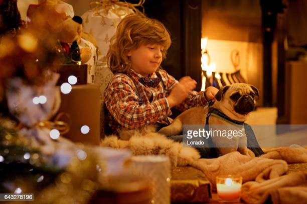 Young boy in christmas scene with festive decorations in indoor setting