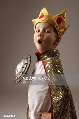 Young boy in costume of a king with crown