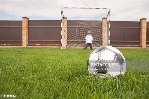 young boy in football goal waiting for the ball