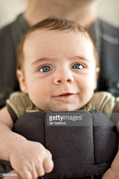 Young boy in front baby carrier with dad