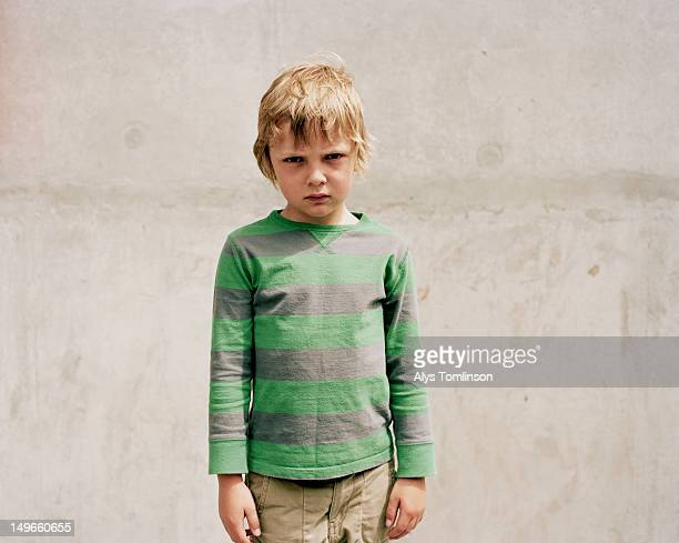 Young Boy in front of a Grey Wall