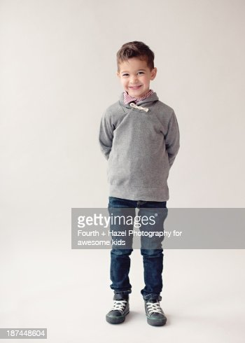 young boy in grey sweater