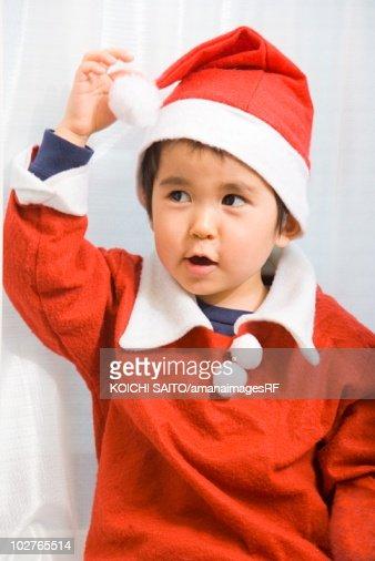 Young boy in Santa suit : Foto de stock