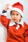 Young boy in Santa suit