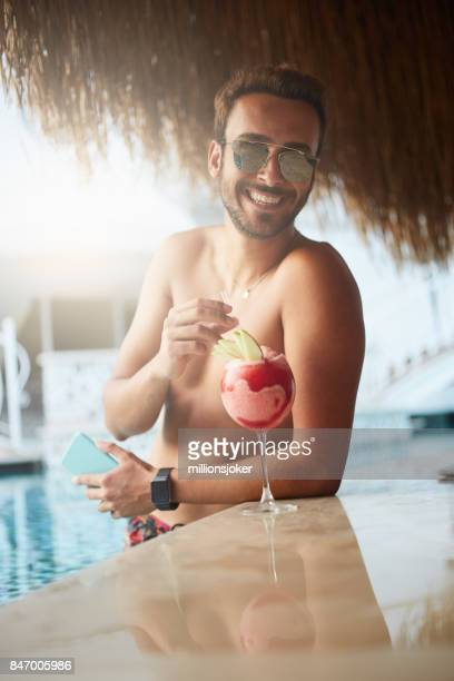 Young boy in the pool and cold drink Milkshake