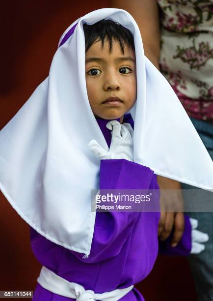 Young boy in traditional clothing during Holy Week in Antigua, Guatemala