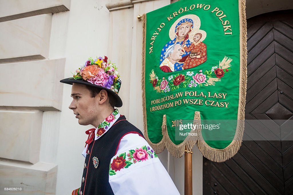 Young boy in traditional polish costumes and a religious pennant during the celebrations of the Corpus Christi, (Boze Cialo), in Lowicz, Poland, on May 26, 2016.
