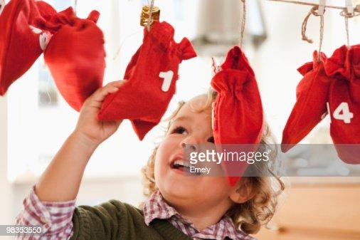 Young boy inspecting christmas sacks