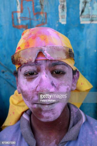 A young boy is coverd with pink power as he celebrates Holi the festival of colour March 22 2008 in Vrindavan India Holi is celebrated for 16 days in...