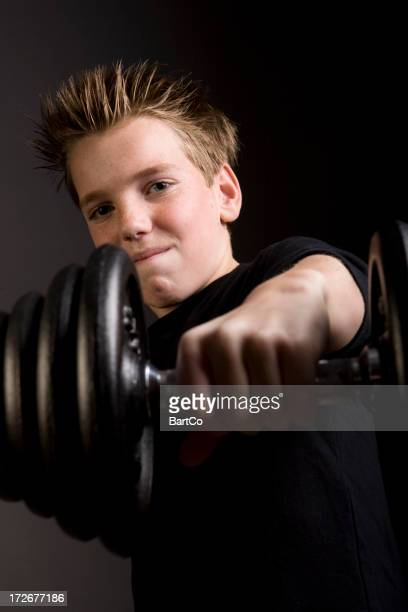Young boy is exercising his body