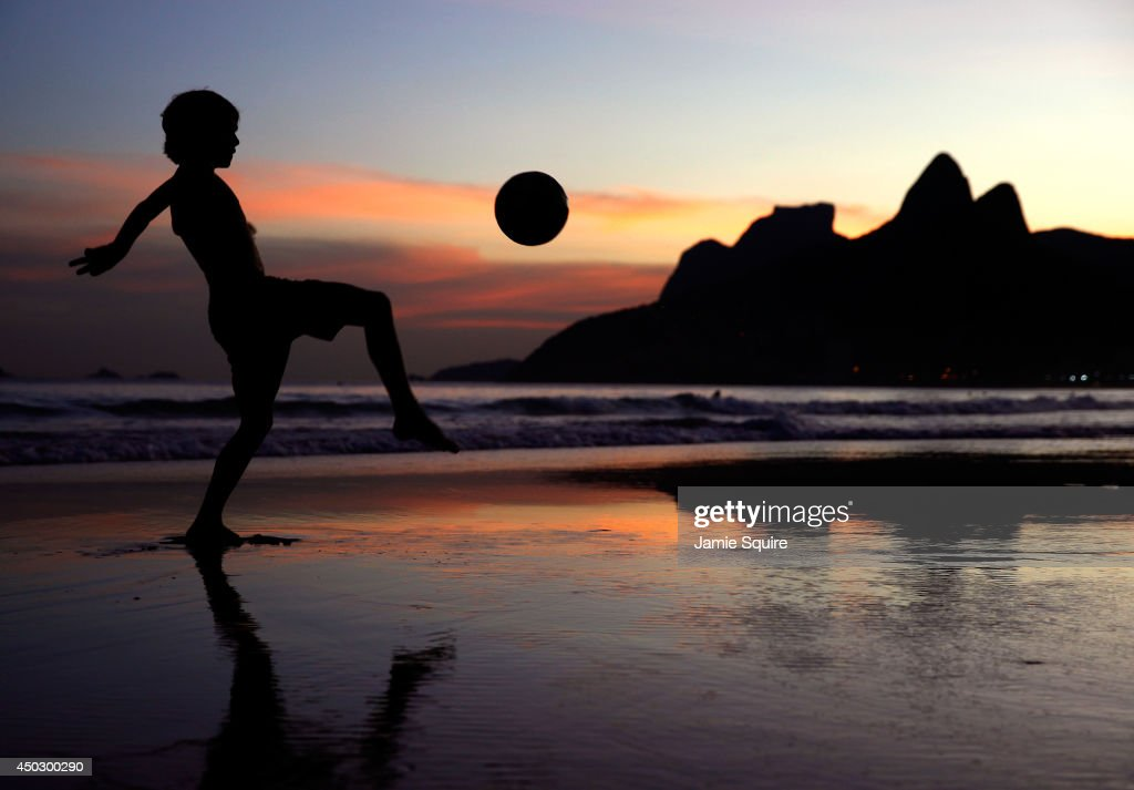 A young boy juggles a football on Ipanema Beach as the 2014 FIFA World Cup nears on June 8, 2014 in Rio de Janeiro, Brazil.
