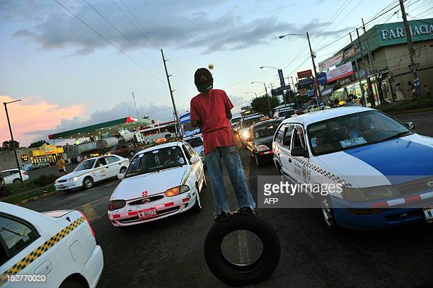 A young boy juggles balls at a street corner in Managua on September 20 2012 Child labour is a growing problem in Central America a region plagued by...