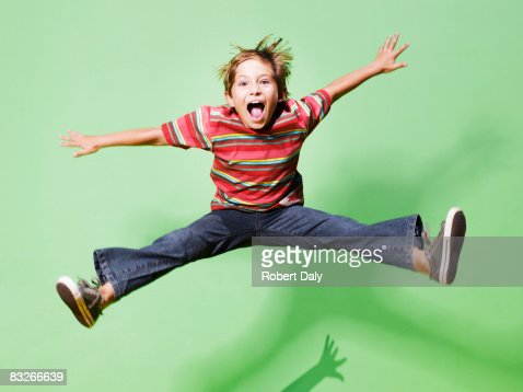 Young boy jumping in mid-air : Stock Photo