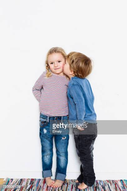 Young boy kissing young girl on cheek