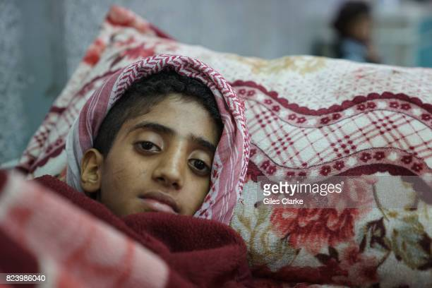 A YEMEN 3 MAY A young boy lies in the emergency room awaiting treatment for suspected cholera The resurgent cholera outbreak which started at the end...