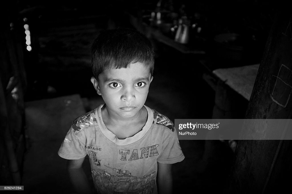 A young boy living with his aunt outside of Kilinochchi displays a brief moment of deep thought His parents went missing during the war and he as not...