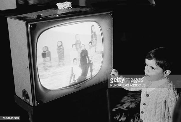 Young Boy Looking At A TV Show In Paris France In October 1967